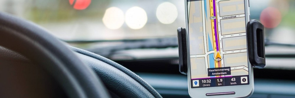 iPhone showing Google maps in a car