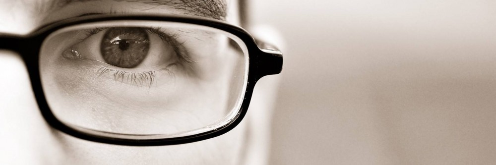 Man with glasses up close