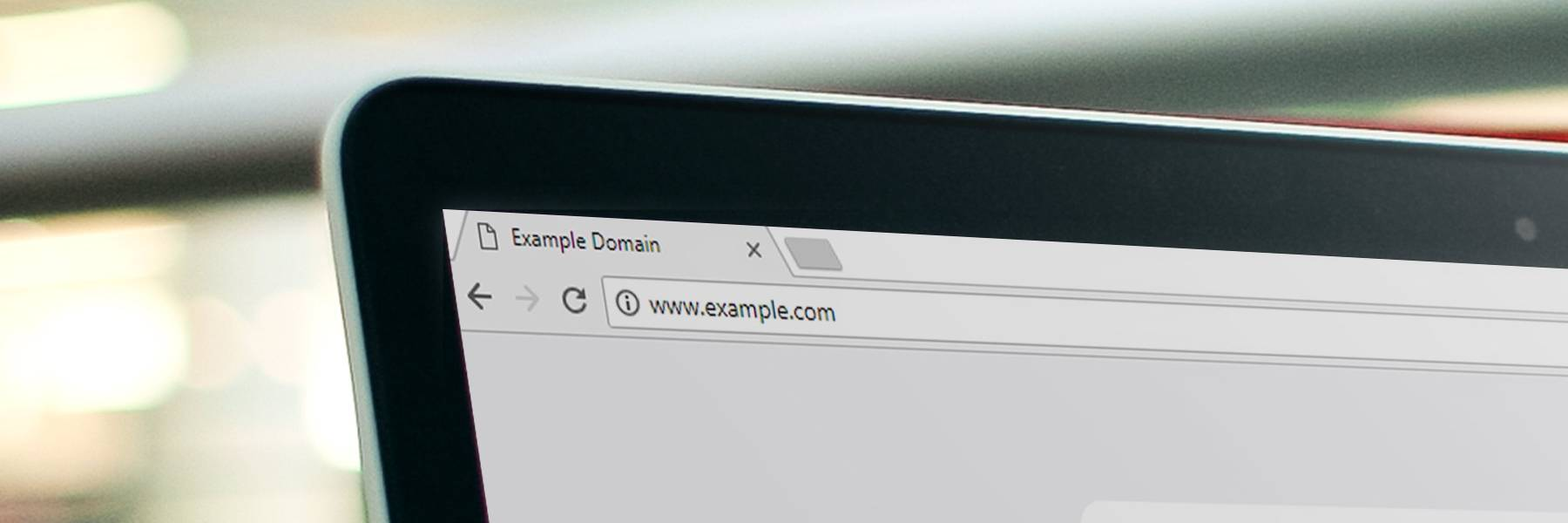 Example domain name shown on laptop